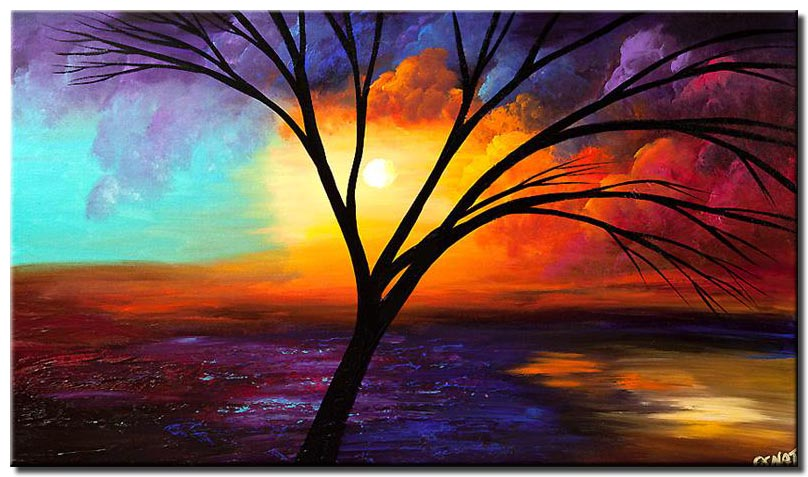 leafless tree over colorful sunrise
