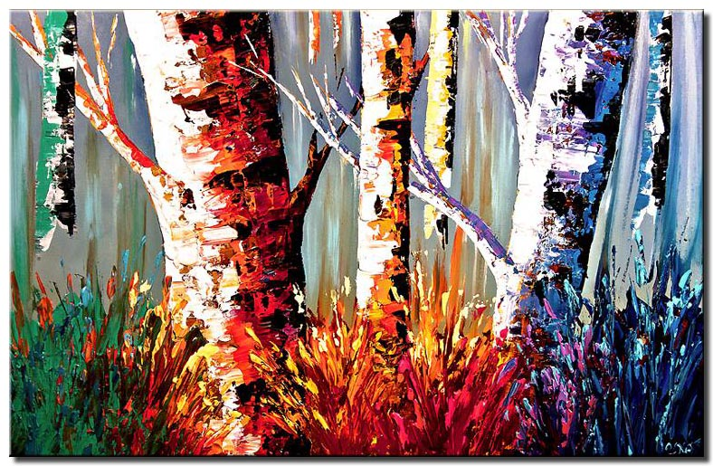 canvas print of colorful tree trunks in forest