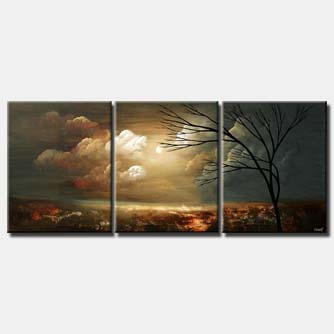 triptych landscape of tree on clouds background