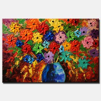 bold colorful textured vase with flowers