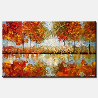 canvas print of blooming trees with reflection in river