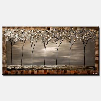 canvas print of seven gray trees in a row