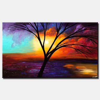 canvas print of leafless tree over colorful sunrise