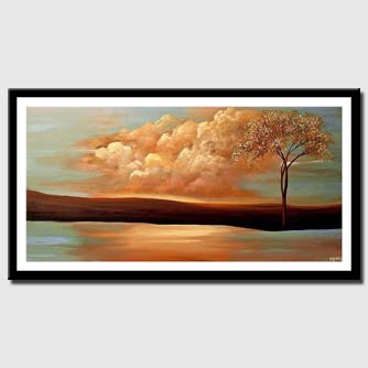 canvas print of single tree on river bank with background of clouds